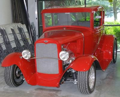 Red antique completely restored at Camarillo Auto Body